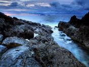 Rugged Rocks Near Shore Backgrounds